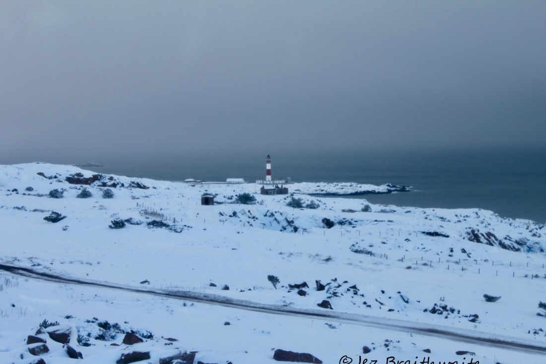 Boddam Lighthouse in a winter storm by Jez Braithwaite
