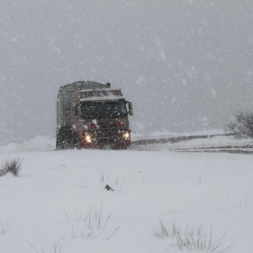 Headlights through the snow by Jez Braithwaite